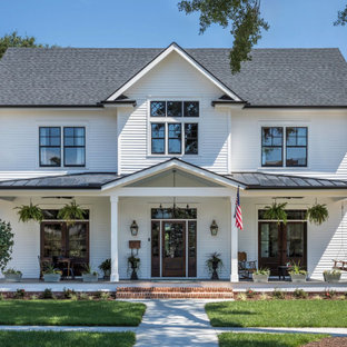 Classic front porch idea in New Orleans with a roof extension
