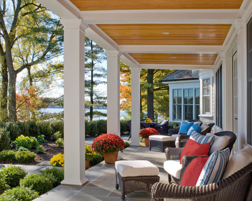 large elegant stone front porch photo in boston with a roof extension - Front Porch Design Ideas