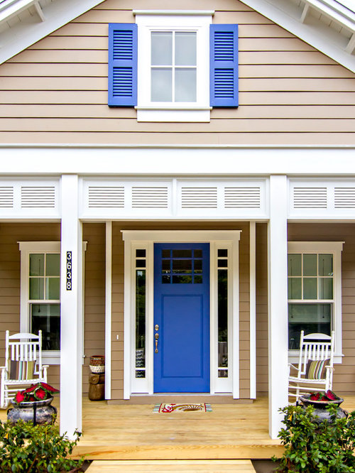 Coastal front porch photo in Jacksonville with decking and a roof extension & Beach House Front Doors | Houzz Pezcame.Com