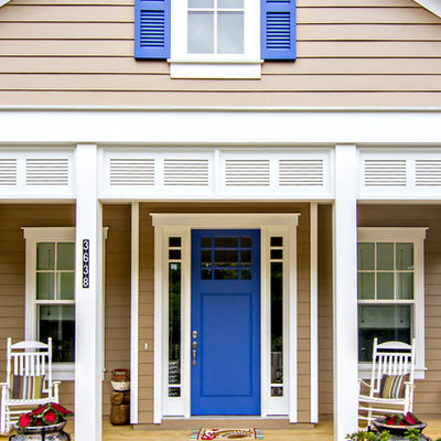 Small beach style front porch photo in Jacksonville with decking and a roof extension