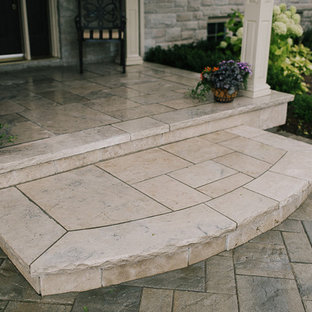 Inspiration for a mid-sized timeless stone front porch remodel in Toronto with a roof extension