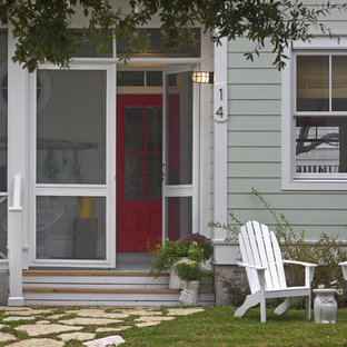 Mid-sized coastal screened-in front porch idea in Atlanta with a roof extension