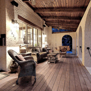 This is an example of a rustic porch design in Atlanta with decking and a roof extension.