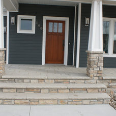 Traditional Porch by Garon Corporation