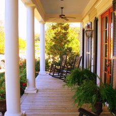 Farmhouse Porch by T-Olive Properties