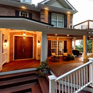 Inspiration for a large craftsman porch remodel in Atlanta with a roof extension and decking