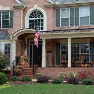 Inspiration for a large transitional stone front porch remodel in Atlanta with a roof extension