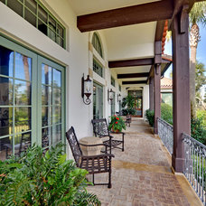 mediterranean porch by Envision Web