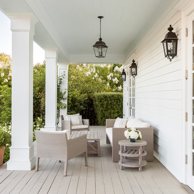 This is an example of a country porch design in San Francisco with decking and a roof extension.
