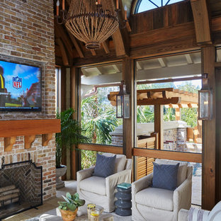 Photo of a beach style veranda in Other with a fire feature and tiled flooring.