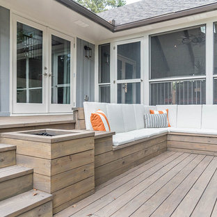 Inspiration for a mid-sized farmhouse screened-in back porch remodel in Atlanta with decking and a roof extension