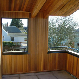 Inspiration for a mid-sized contemporary tile back porch remodel in Seattle with a roof extension