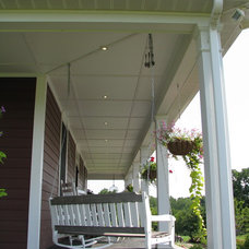Farmhouse Porch by Mark Austin Building and Remodeling