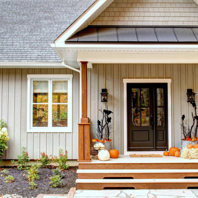Large country porch photo in Montreal with a roof extension