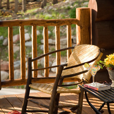 Large mountain style front porch photo in Other with decking and a roof extension