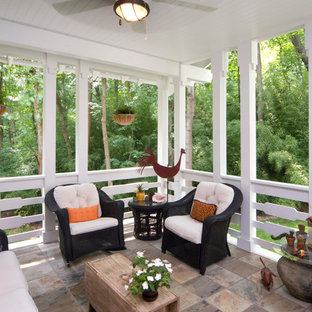Large transitional tile screened-in back porch photo in Houston with a roof extension