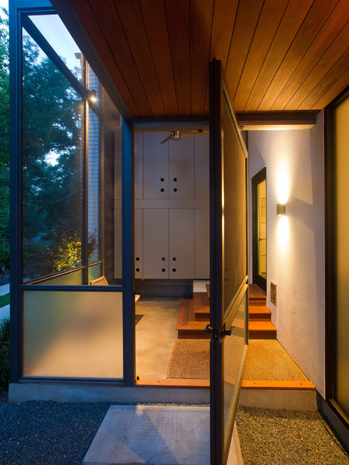 This Is An Example Of A Modern Porch Design In Austin With A Roof Extension.