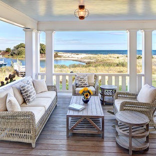 This is an example of a beach style porch design in Boston with decking and a roof extension.