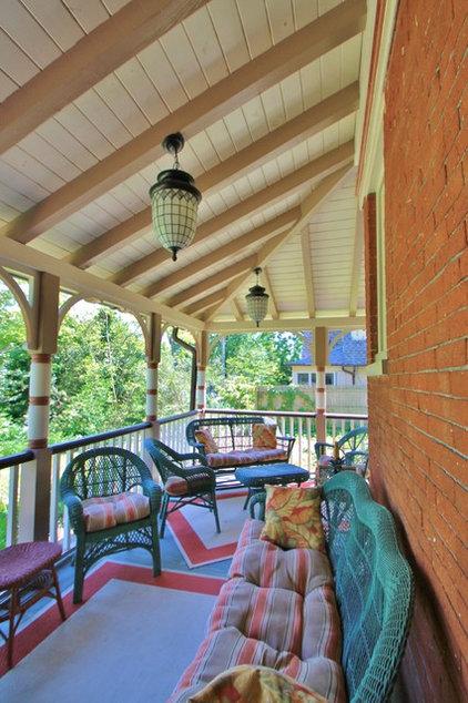 Traditional Porch by Custom Woodcraft Inc.