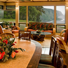 Tropical Porch by Fine Design Interiors, Inc