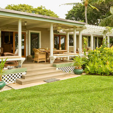 Tropical Porch by Fine Design Interiors, Inc
