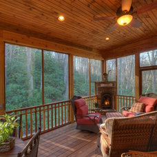 Rustic Porch by Barnette Builders, LLC
