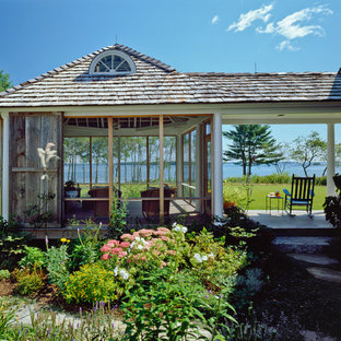 Ornate screened-in porch photo in Portland Maine with a roof extension
