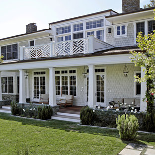 This is an example of a traditional porch design in Los Angeles with decking and a roof extension.