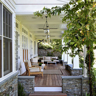 Elegant porch photo in Los Angeles with decking and a roof extension