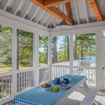 Cottage screened-in porch idea in Portland Maine with decking and a roof extension
