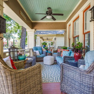Small arts and crafts front porch idea in Dallas with decking and a roof extension