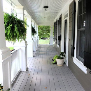 Inspiration for a large craftsman front porch remodel in DC Metro with decking and a roof extension