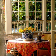 eclectic porch by Susan Hunter Interiors