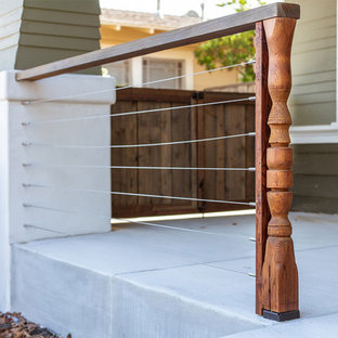 Inspiration for a mid-sized craftsman concrete front porch remodel in San Diego with a pergola