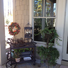 Eclectic Porch by Total Quality Home Builders, Inc.