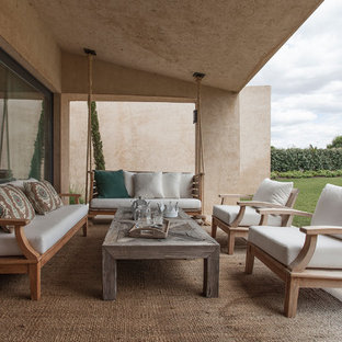 Inspiration for a large rustic tile back porch remodel in Madrid with a roof extension