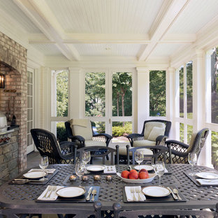Large elegant stone screened-in back porch photo in DC Metro with a roof extension