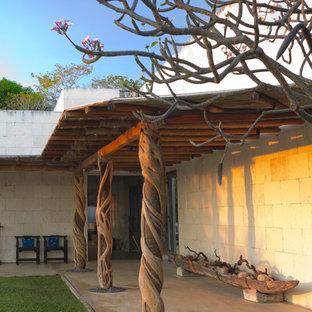 Idee per un portico bohémian con lastre di cemento