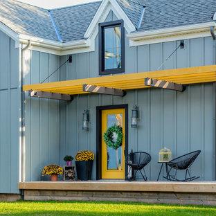 Foto di un portico country con pedane e una pergola