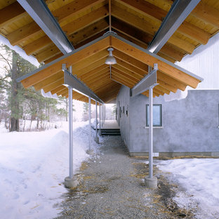 Inspiration for an industrial porch remodel in Seattle with a roof extension