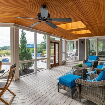 Mid-sized beach style screened-in back porch idea in Boston with a roof extension and decking