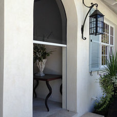 Mediterranean Porch by All About Windows Inc