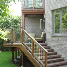 Traditional Porch by Forest Fence & Deck Co Ltd.