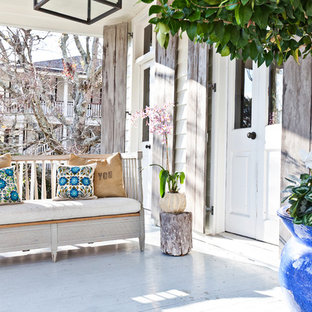 Cottage chic porch idea in Charleston with decking and a roof extension