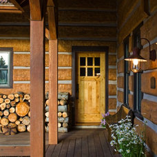 rustic porch by EverLog™ Systems: Worry Free Concrete Logs
