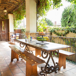 Tuscan tile porch photo in Los Angeles