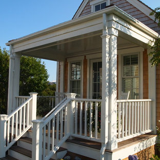 Mid-sized victorian front yard verandah in Boston with decking and a roof extension.