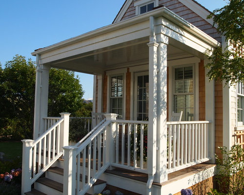 Mid Sized Ornate Front Porch Idea In Boston With Decking And A Roof  Extension