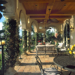 mediterranean porch by John McDonald Co.