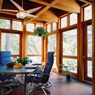 Eclectic screened-in porch idea in Minneapolis with decking and a roof extension